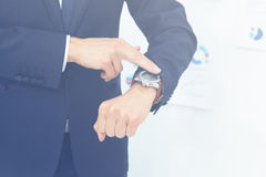 Idea is to save time. businessman pointing at his wristwatch Stock Photography