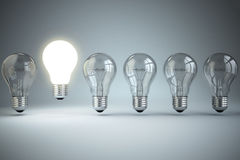 Idea or uniqueness, originality concept. Row of light bulbs with Royalty Free Stock Images