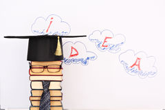 Idea. Unusual student parody on a background of idea word in clouds stock illustration