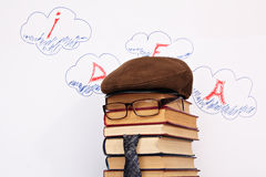 Idea. Unusual student parody on a background of idea word in clouds royalty free stock image