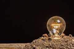 Idea. Vision closeup soil electric save copy Royalty Free Stock Photography