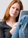 Idea - Woman with a Tablet Royalty Free Stock Photos