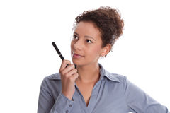 Idea: woman thinking with pen in hand isolated on white backgrou Stock Photo