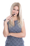 Idea: woman thinking with pen in hand isolated on white backgrou Stock Photos