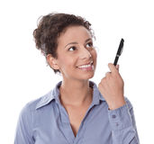 Idea: woman thinking with pen in hand isolated on white backgrou Stock Image