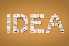 IDEA word arranged from books. IDEA word formed from books, shot from above on yellow background Stock Images