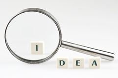 Idea word and magnifying glass Royalty Free Stock Photo