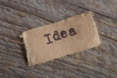 Idea - word on a piece of paper close up, business creative motivation concept. Success, education, corporate, typewriter, commerce, competence, creativity royalty free stock photos