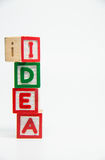 IDEA word wooden block arrange in vertical style on white background and selective focus Royalty Free Stock Photography