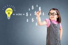 Idea and work can make lots of money equation draw by cute little girl. Blue background. Stock Photography