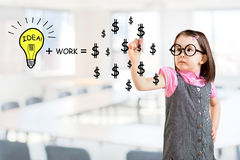 Idea and work can make lots of money equation draw by cute little girl. Office background. Stock Images