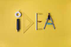 Idea written with office supplies Royalty Free Stock Images
