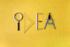 Idea written with office supplies Royalty Free Stock Photos
