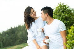 Ideal morning. Image of a young couple meeting the morning on the balcony Stock Photo