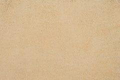 ideal sandtextur för bakgrunder Brun sand Bakgrund från fin sand Gulingen färgar version Royaltyfri Bild