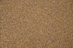 ideal sandtextur f?r bakgrunder Gulingen f?rgar version Bakgrund f?r strand sand Top besk?dar arkivbild