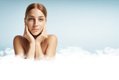 Ideal skin of woman. Woman with ideal skin in a clouds Stock Photos