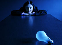 Ideas 2. Bulb and young woman in low key stock photos