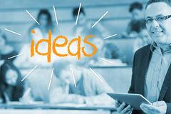 Ideas against lecturer standing in front of his class in lecture hall Royalty Free Stock Photography