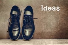 Ideas on brown board and work shoes on wooden floor. To mean a concept, aspirations, imagination, innovation, inspiration, begin, black, blank, break, choice stock photos