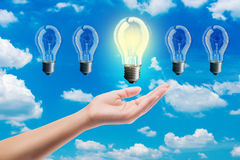 Ideas bulb light on a hand Royalty Free Stock Images