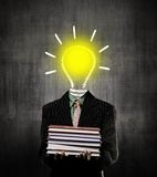 Ideas Bulb Man Holding Books Wearing Suit, Near Chalkboard Royalty Free Stock Image