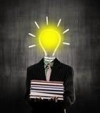 Ideas Bulb Man Holding Books Wearing Suit, Near Chalkboard Royalty Free Stock Image