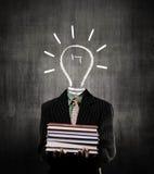 Ideas Bulb Man Holding Books Wearing Suit, Near Chalkboard Stock Photos