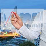 Ideas of Business Profits. Ideas of Business Profits,hands of a business man use a red pen pointing to the top of the red arrow Stock Image