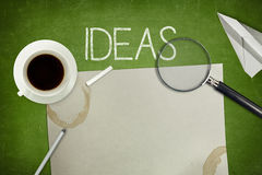 Ideas concept on black blackboard with empty paper Stock Images
