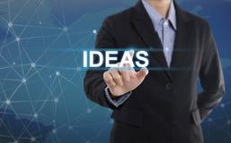 Ideas del botón del presionado a mano del hombre de negocios Imagenes de archivo