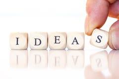 Ideas, deletreadas con las letras de los dados Imagen de archivo libre de regalías