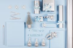 Ideas for design christmas decorations and plank paper as wishlist - soft light pastel blue and silver metallic gift boxes. royalty free stock images
