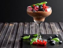 Ideas for a healthy diet. Dietary Chocolate mousse, parfait with fresh berries of raspberries, blueberries and red currants in a g. Lass goblet Royalty Free Stock Image