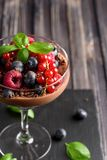 Ideas for a healthy diet. Dietary Chocolate mousse, parfait with fresh berries of raspberries, blueberries and red currants in a g. Lass goblet Stock Image