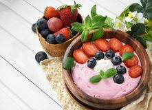Ideas for healthy summer breakfast op dessert. Smoothies in bowl stock photos