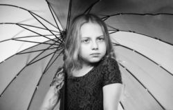 Ideas how survive cloudy autumn day. Small girl with umbrella rainy day weather. Little girl with umbrella. Autumn royalty free stock images
