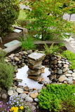 Ideas for landscaping home garden. Fountain with rocks Royalty Free Stock Photography