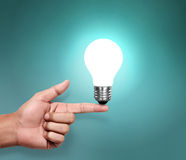 Light bulb in a hand Stock Images