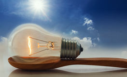 Ideas,Light bulb that shines on the ladles Stock Photos