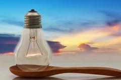 Ideas,Light bulb that shines on the ladles. Ideas,Light bulb that shines on the ladle with a sky evening Stock Photos