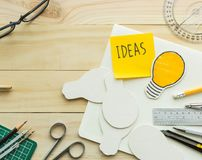 Ideas message on notepad on work table with elements. Of tools,equipment.Creativity decoration design and handmade concepts Stock Images