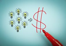 Ideas and money. Concept is on blue paper with a red marker aside Royalty Free Stock Image