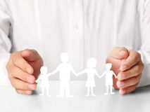Ideas,paper family in  hand Stock Image