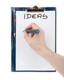 Ideas sign on an empty document in a clipboard Royalty Free Stock Image