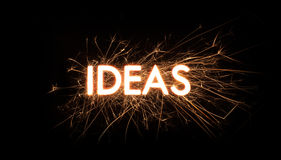 IDEAS title word in glowing sparkler Stock Photo