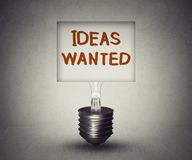 Ideas wanted concept and talent search symbol. Sign with classified ad symbol in empty lightbulb search for new innovative thoughts icon of business Stock Photography