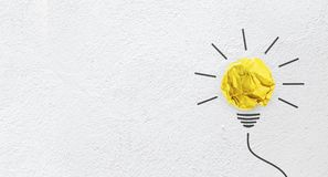Free Ideas With Yellow Paper Crumpled Ball On Wall Background Stock Photography - 99766672