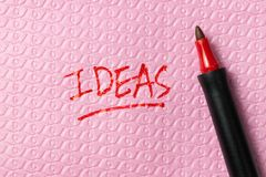 Ideas word written on napkin Royalty Free Stock Image