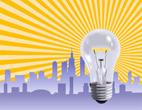 Ideas at Work. Ideas that make the business world work represented by a light bulb Royalty Free Stock Photography
